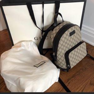 Gucci supreme mini backpack